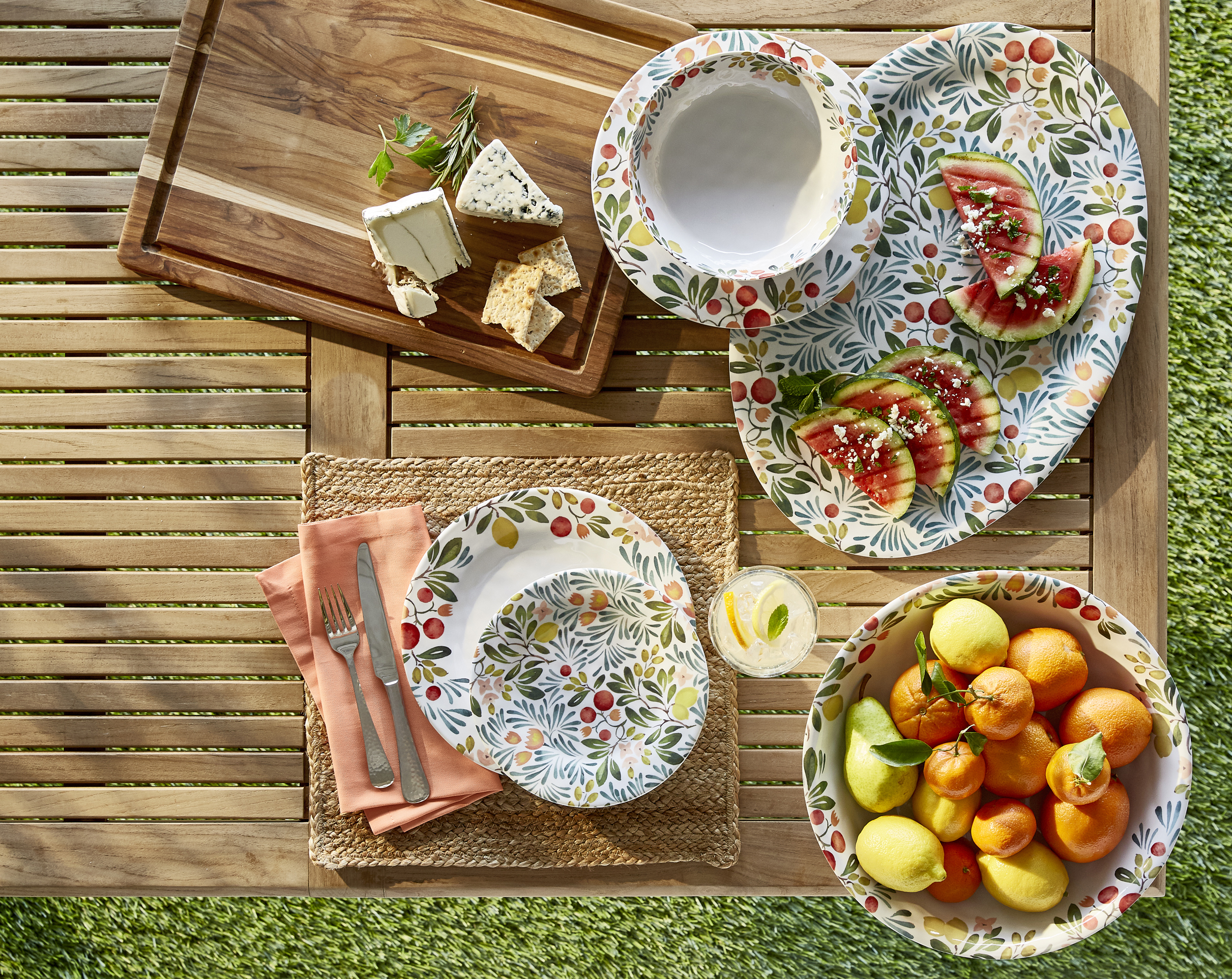 cheese-board-fruit-bowl-on-outdoor-table