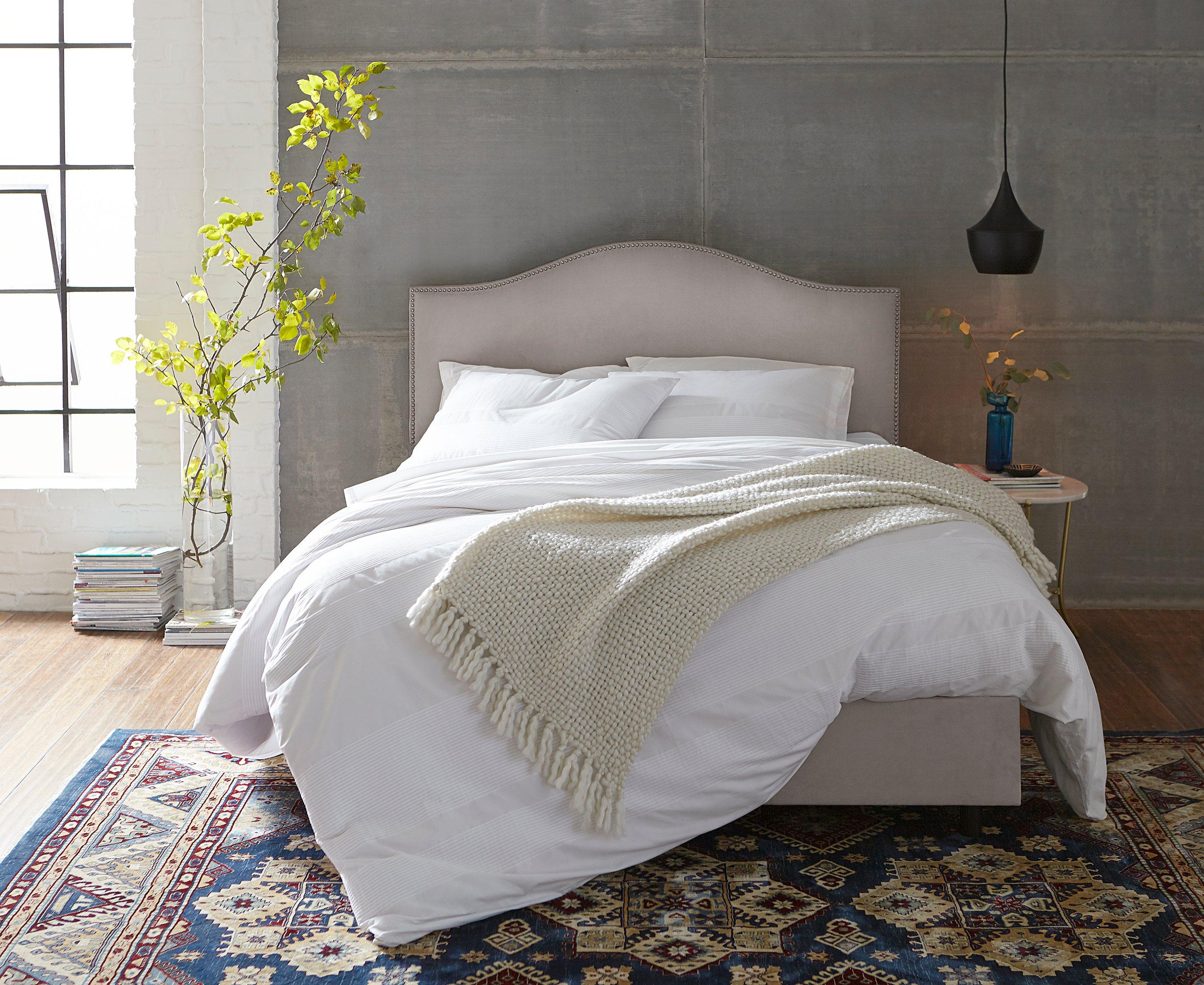 bedroom-white-comforter-linen-headboard-open-window-plants
